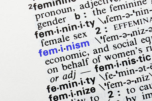 Feminism. Closeup of dictionary word entry. stock photo