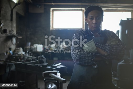istock Feminist working in smithy 653084114