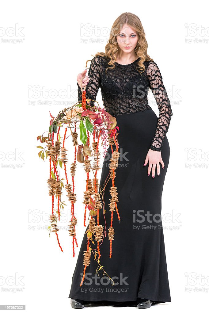 Femme Fatale With Cascade Shape Flower Arrangement stock photo
