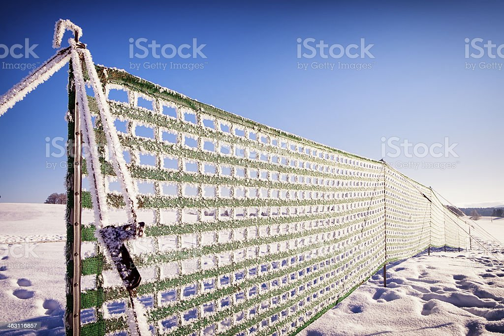 fence against snowdrift stock photo