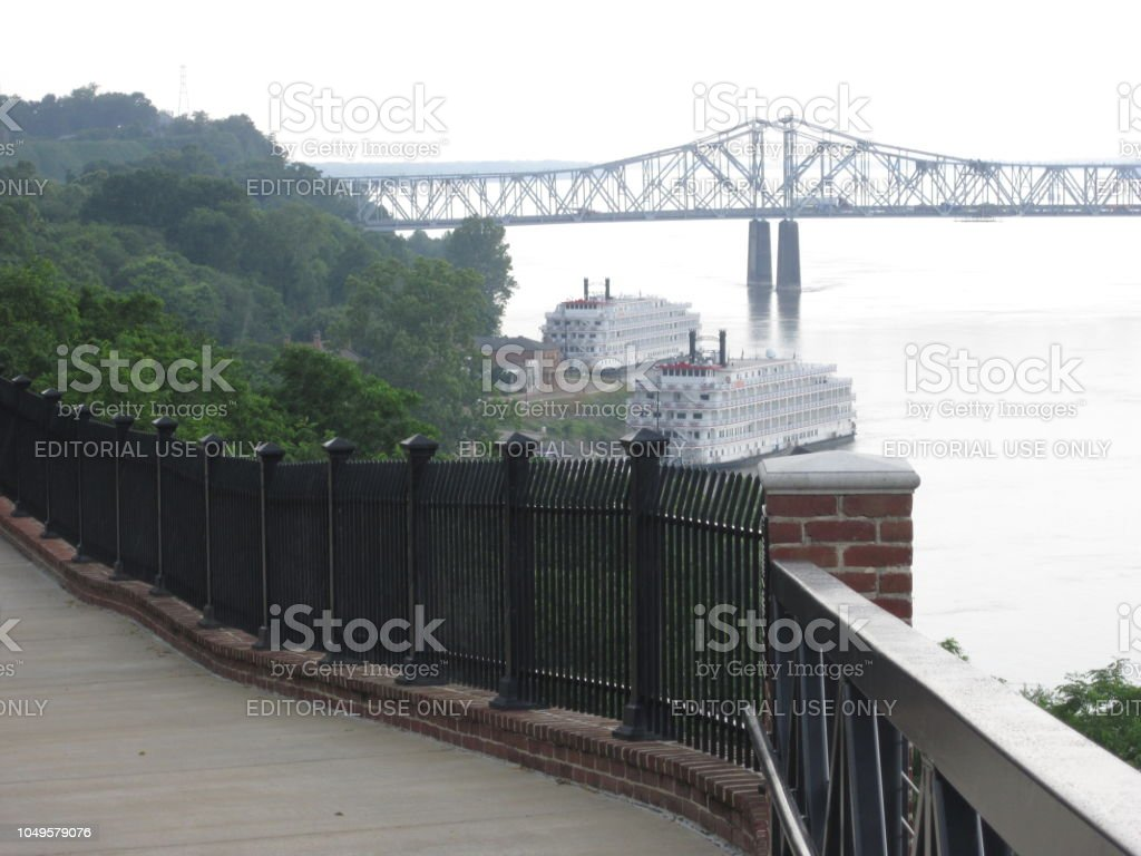 Fence and Bridge Along Mississippi River stock photo