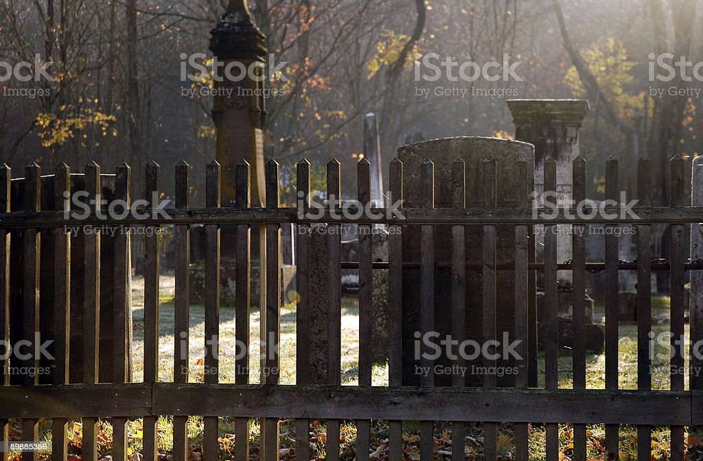 Fence and Cemetery at Misty Sunrise royalty-free stock photo