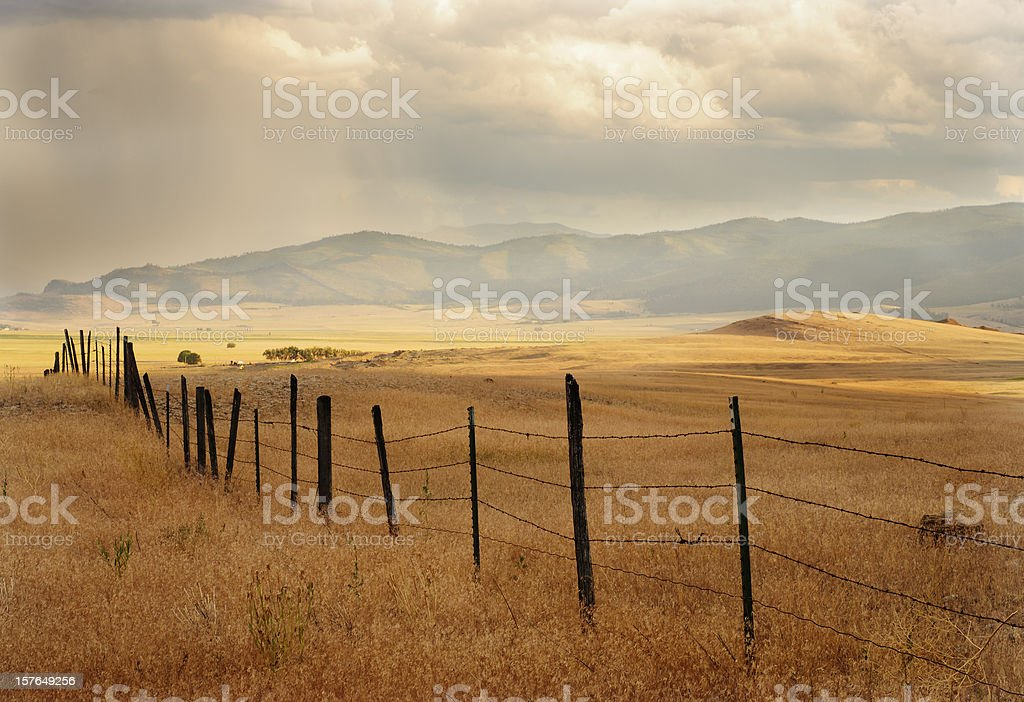 Fence and Farmland royalty-free stock photo