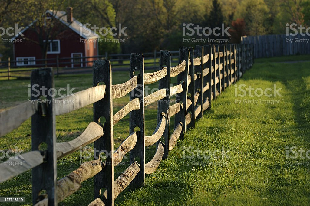 Fence and red House stock photo