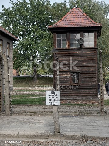 Oswiecim, Poland - 24th Sep 2019: Fence and watchtower at Auschwitz-Birkenau concentration and extermination camp near Oswiecim in Poland.  Now an historical monument, it is estimated that the Nazis murdered over a million Jewish people, Polish people, Soviet POWs and other ethnic groups at the camp between 1940 and 1945.