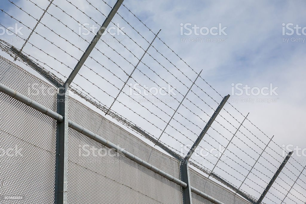 Fence around restricted area stock photo