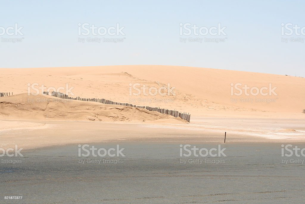 Fence at the Beach, Lagoon of Walvis Bay, Namibia, Africa stock photo