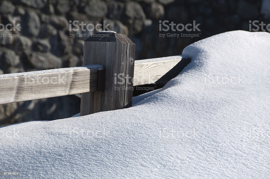 Fence covered by powder snow royalty-free stock photo