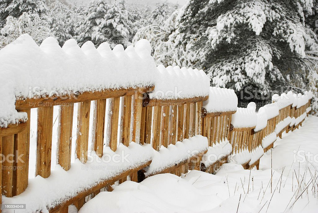 fence covered with snow royalty-free stock photo