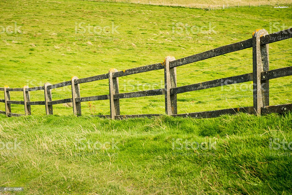 Fence in field stock photo