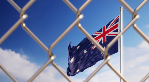 Fence In Front Of Australian Flag Fence in front of Australian flag. Illegal immigration concept. Horizontal composition with copy space. deportation stock pictures, royalty-free photos & images