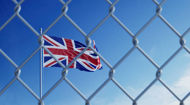 Fence In Front Of British Flag Fence in front of British flag. Illegal immigration concept. Horizontal composition with copy space. deportation stock pictures, royalty-free photos & images