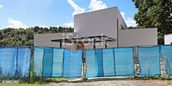 istock A fence made of metal mesh and a blue synthetic tarpaulin 815622452
