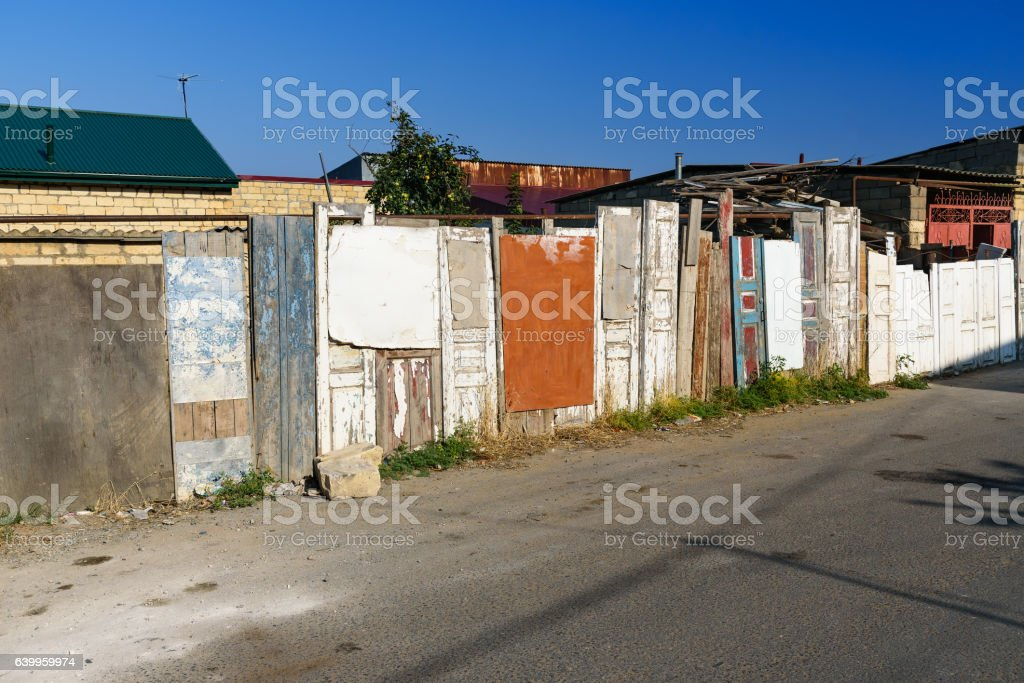 Fence made of old doors stock photo