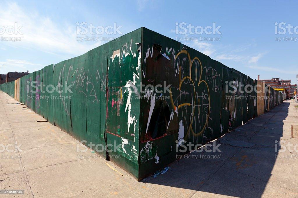 Fence on Street Corner stock photo