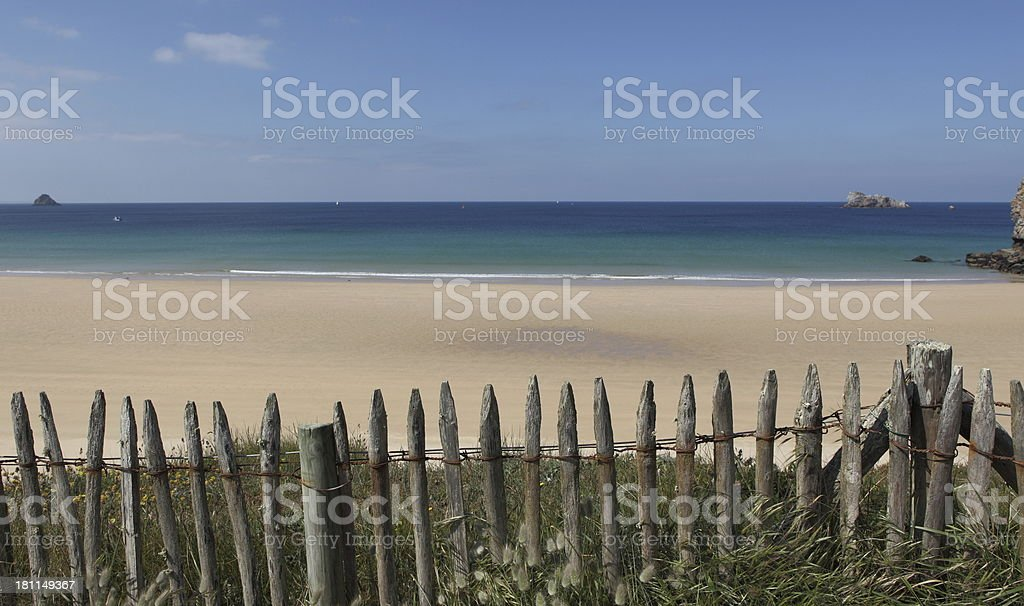 Fence on the beach stock photo