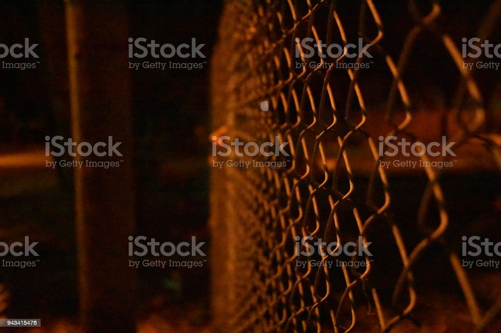 Fence perspective shot at night stock photo
