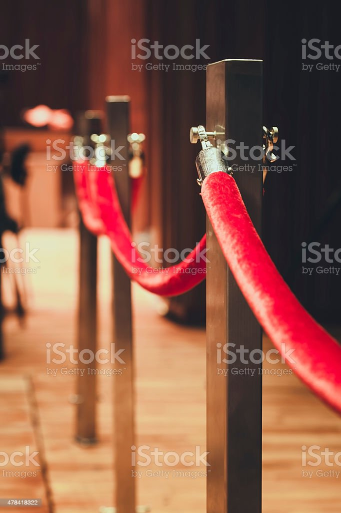 Fence pole attached with red rope Red carpet area stock photo