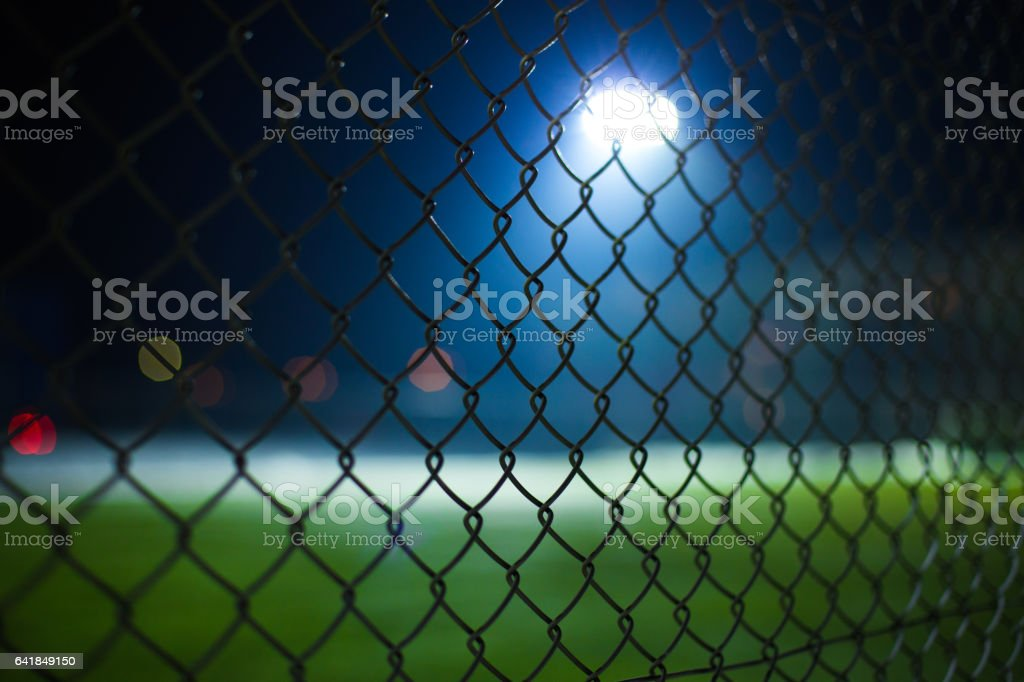 Fence, spotlights, night stock photo