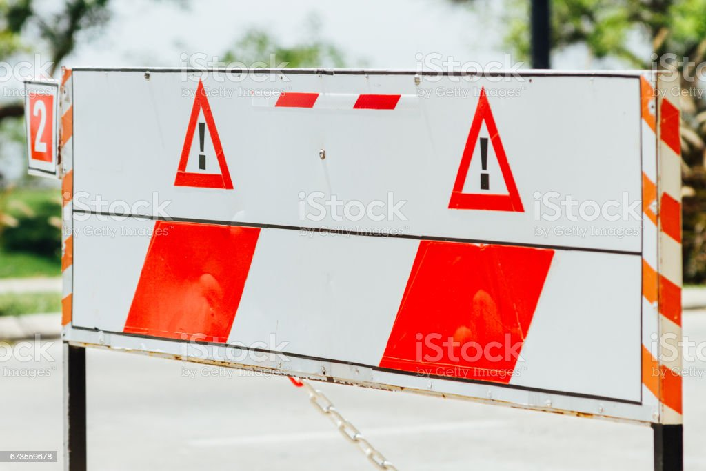 Fence warning sign on a street royalty-free stock photo