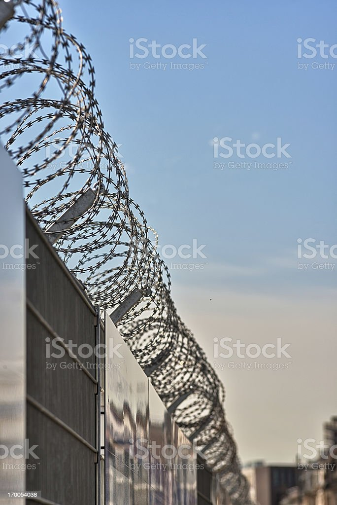 Fence with barbed wire royalty-free stock photo