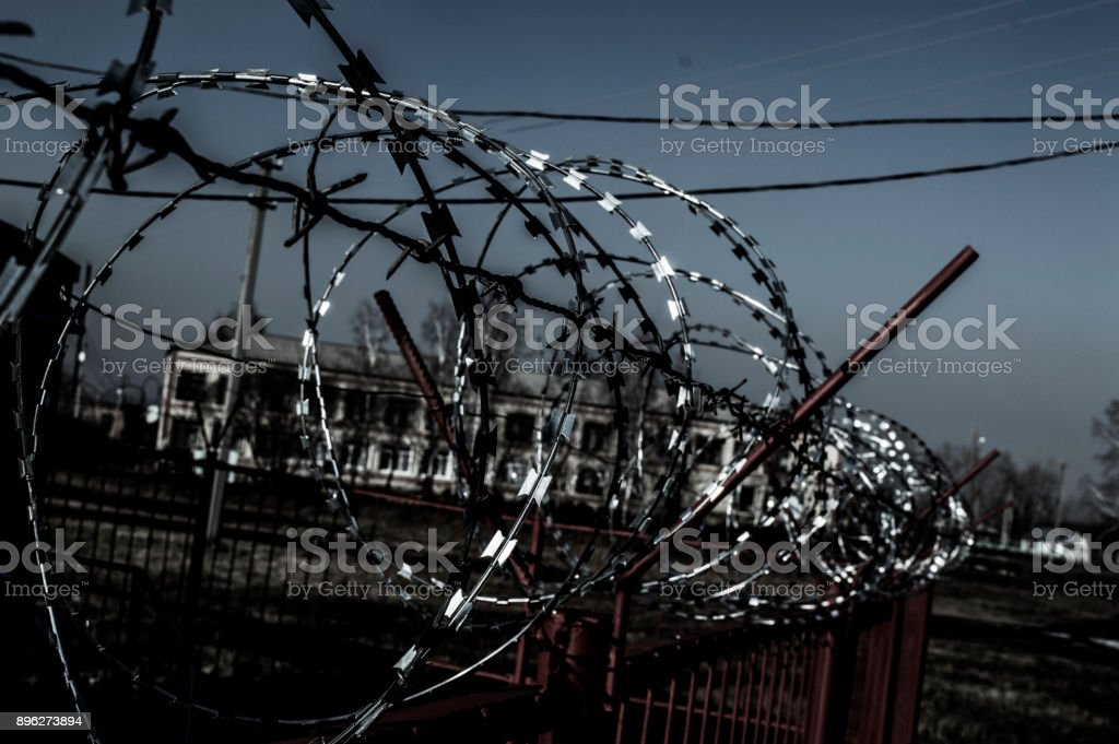 Fence with barbed wire. Restricted area. Protected area stock photo