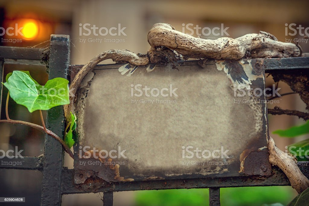 Fence with empty number plate stock photo