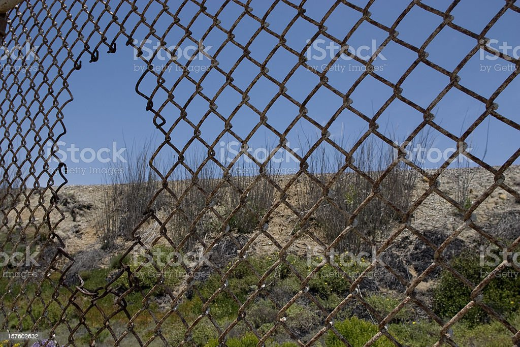 Fence with hole stock photo
