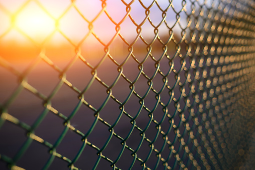 istock fence with metal grid in perspective 928863520