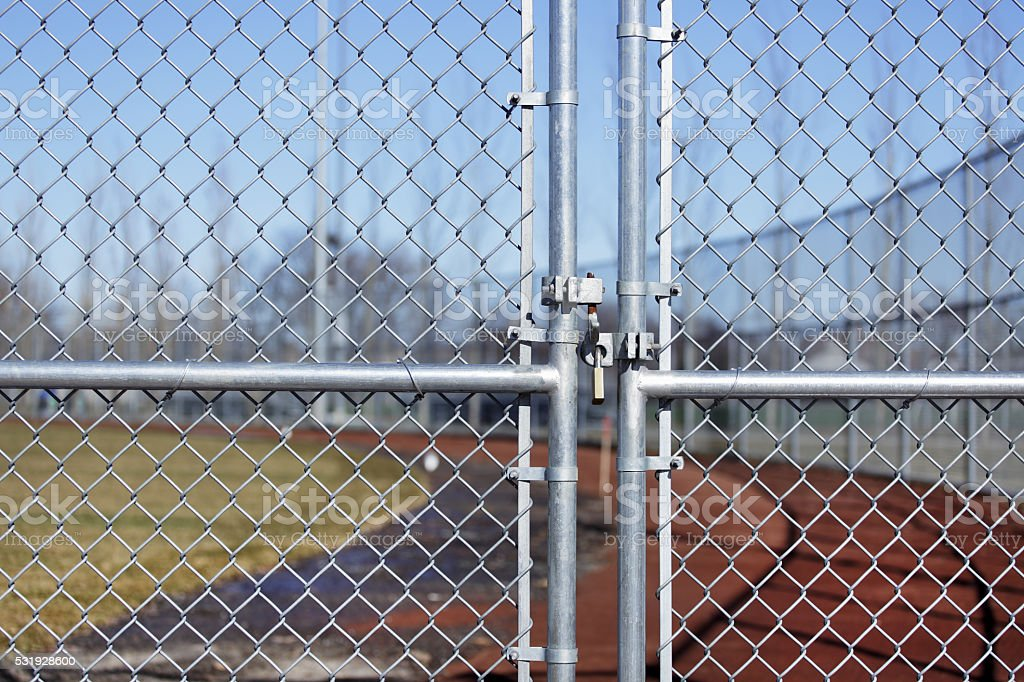 Fenced locked with padlock. stock photo