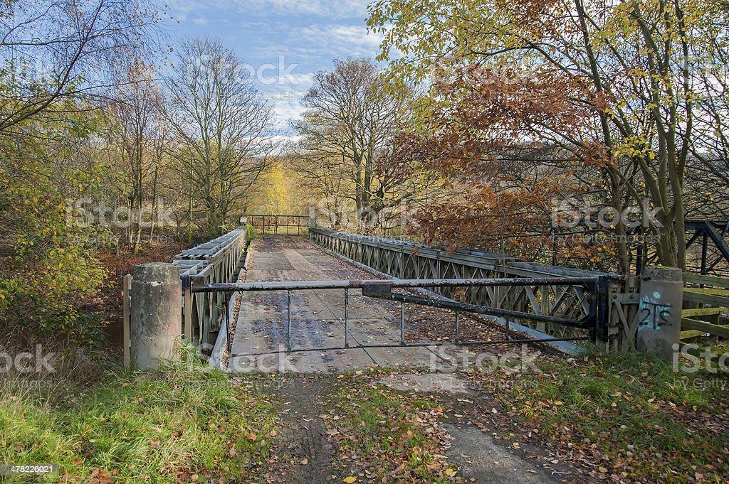 fenced road bridge stock photo