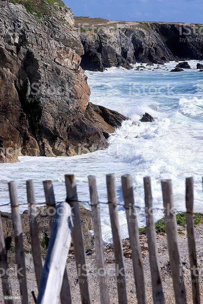 fenced seashore royalty-free stock photo
