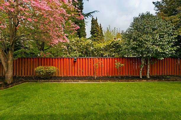 fenced yard - fence stock photos and pictures