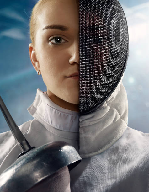 Fencer portrait with half face masked stock photo