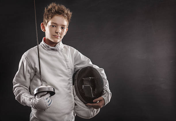 Fencer with fencing mask stock photo