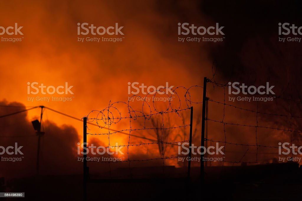 Fences with barbed wire, storage fire stock photo