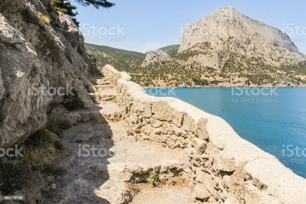 Fencing of the trail made of stone. royalty-free stock photo