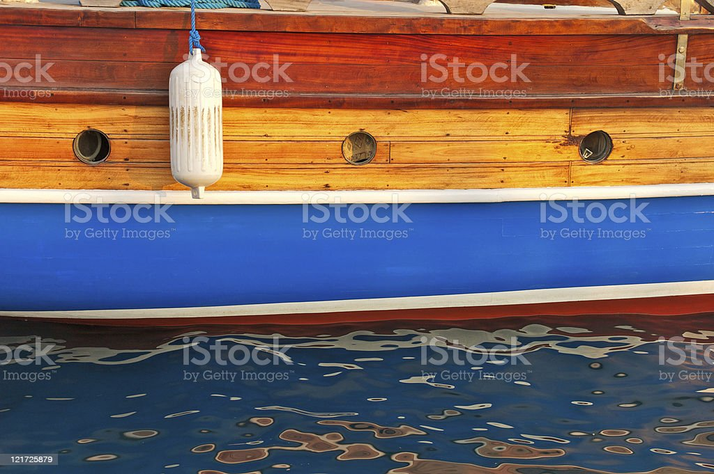 Fender on the side of turkish sailboat stock photo