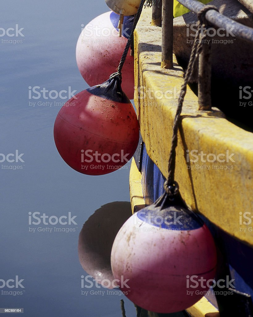 Fenders on fishing boat royalty-free stock photo