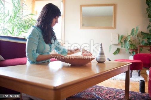 Feng Shui designer working in domestic room.