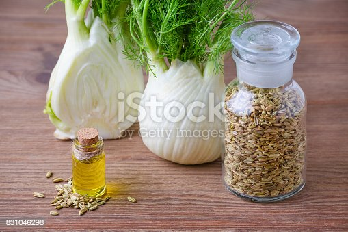 istock fennel essential oil, bulb and seeds, selective focus on dark wooden 831046298