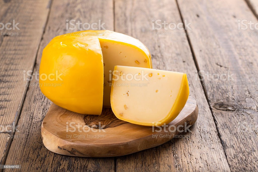 Fenugreek gauda herb cheese stock photo