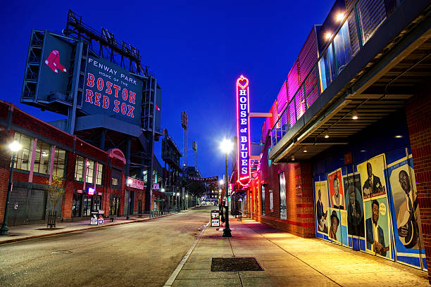 Fenway Park and the House of Blues along Landsdowne Street Boston, Massachusetts, USA - April 24, 2016: Night view of Fenway Park and the House of Blues along Landsdowne Street in the Fenway–Kenmore neighborhood. major league baseball stock pictures, royalty-free photos & images