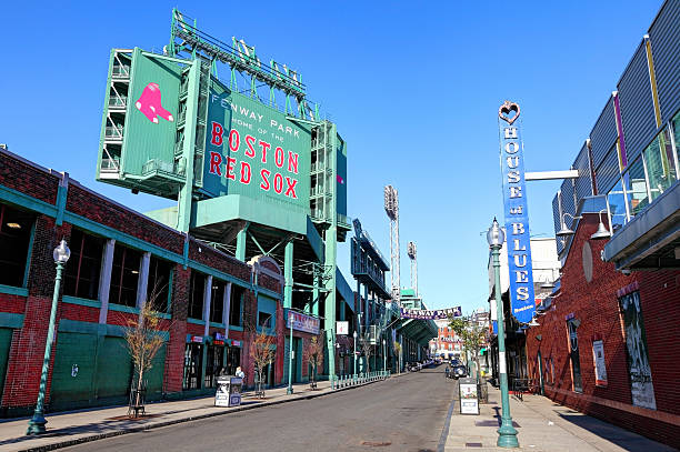 Fenway Park and the House of Blues along Landsdowne Street Boston, Massachusetts, USA - April 24, 2016: Daytime view of Fenway Park and the House of Blues along Landsdowne Street in the Fenway–Kenmore neighborhood. major league baseball stock pictures, royalty-free photos & images