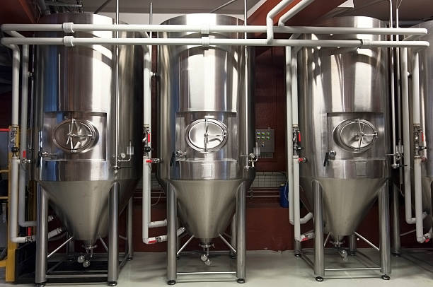 fermentation tanks in a micro brewery - brewery tanks stock pictures, royalty-free photos & images