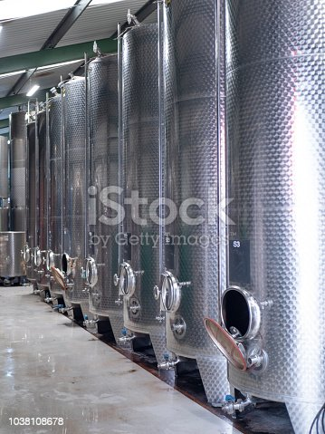 Large stainless steel vats in a winer
