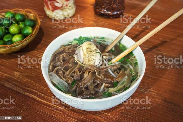 Fermented balut egg in a bowl an exotic soup with pho noodles on the picture id1165422200?b=1&k=6&m=1165422200&s=612x612&h=ltzxz1ircux2apblqdhhznkn883fbhffrhx 9dlqdxy=