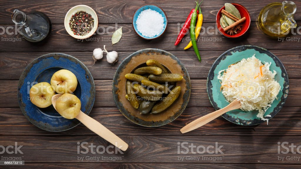Fermented food, probiotic sources, sauerkraut, cabbage, top view. stock photo