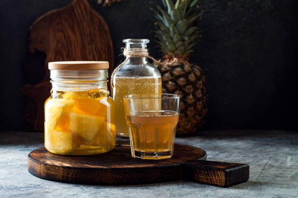 Fermented mexican pineapple Tepache. Homemade raw kombucha tea with pineapple. Healthy natural probiotic flavored drink. Fermented mexican pineapple Tepache. Homemade raw kombucha tea with pineapple. Healthy natural probiotic flavored drink. Copy space fermenting stock pictures, royalty-free photos & images