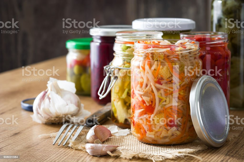 Fermented preserved vegetables in jar stock photo